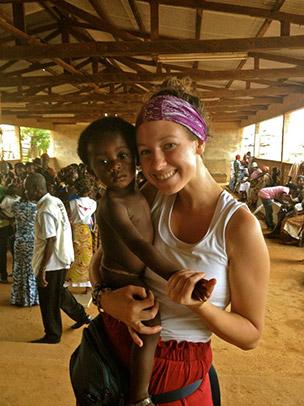 Dana Humphrey holding a child in Ghana.