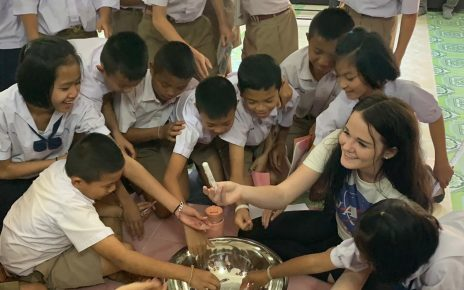 Students gather around a bowl of salt at an elementary school in Thailand